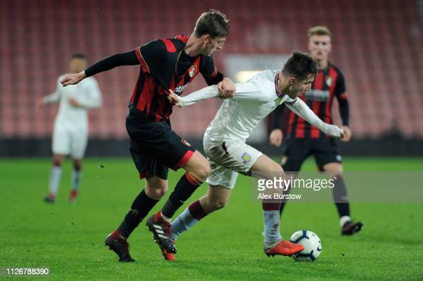 Indiana Vassilev of Aston Villa battles for possession with Tom Hanfrey of AFC Bournemouth during the FA Youth Cup Fifth Round Match between AFC...