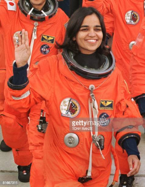 IndianAmerican astronaut Kalpana Chawla waves as she walks out of the Operations and Checkout Building at the Kennedy Space Center FL 19 November and...