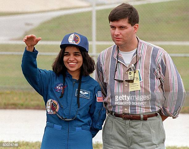IndianAmerican astronaut Kalpana Chawla waves to well wishers and family members during a photo opportunity in the perimeter of launch pad 39B at the...