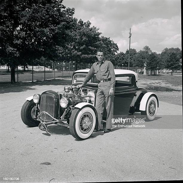 Indianapolis 500 1955 Member of the Flywheels Car Club stands next to his hot rod 1932 Ford 3window coupe powered by a Cadillac V8