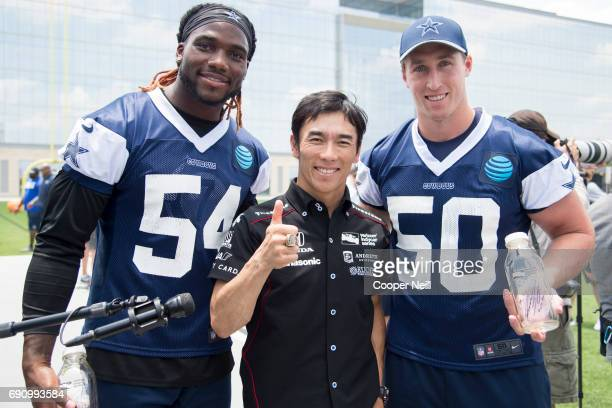 Indianapolis 500 Champion Takuma Sato poses for a photo with Jaylon Smith and Sean Lee after the Dallas Cowboys finished practice at The Star on May...