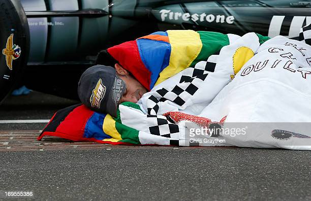 Indianapolis 500 Champion Tony Kanaan of Brazil driver of the Hydroxycut KV Racing TechnologySH Racing Chevrolet wraps himself in the winner's quilt...