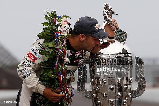 Indianapolis 500 Champion Tony Kanaan of Brazil driver of the Hydroxycut KV Racing TechnologySH Racing Chevrolet kisses the Borg Warner Trophy at the...