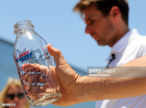 Indianapolis 500 Champion WIll Power autographed a milk bottle for Dallas Cowboys Zack Martin durign practice at The Ford Center at The Star on May...