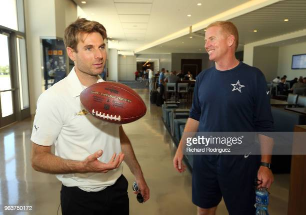 Indianapolis 500 Champion WIll Power tosses an autographed football given to him by Dallas Cowboys head coach Jason Garrett after practice at The...