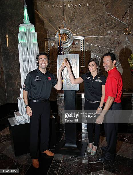 Indianapolis 500 drivers Dario Franchitti Danica Patrick and Helio Castroneves light The Empire State Building green to celebrate the 100th...
