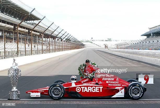 Indianapolis 500 winner Scott Dixon driver of Target Chip Ganassi Racing Dallara Honda poses with his car and the BorgWarner trophy during the IRL...