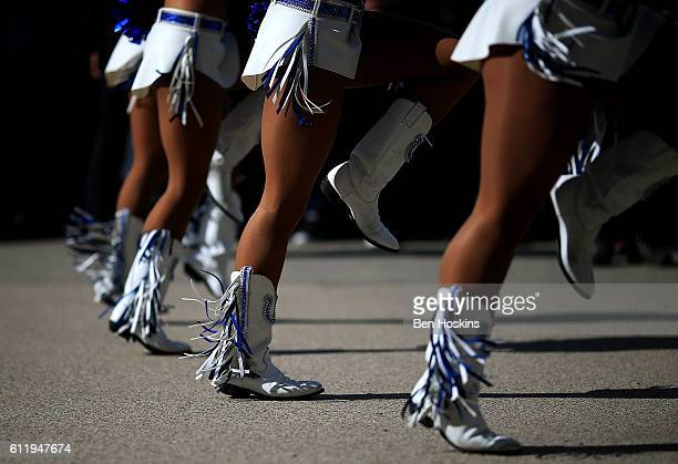 Indianapolis Colts cheerleaders perform outside the stadium ahead of the NFL International Series match between Indianapolis Colts and Jacksonville...