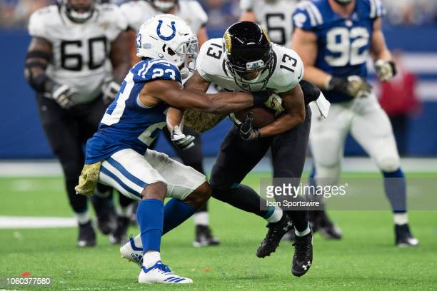 Indianapolis Colts cornerback Kenny Moore II rips the ball from Jacksonville Jaguars wide receiver Rashad Greene Sr to seal the win during the NFL...