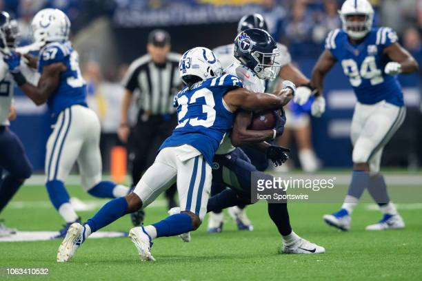 Indianapolis Colts cornerback Kenny Moore II tackles Tennessee Titans wide receiver Corey Davis after a short catch during the NFL game between the...