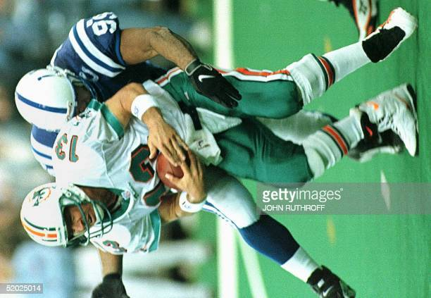 Indianapolis Colts defensive end Al Fontenot sacks Miami Dolphins quarterback Dan Marino during the second quarter of the Colts' 41-0 victory over...