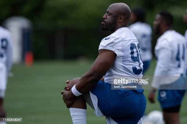 Indianapolis Colts defensive end Justin Houston stretches before the Indianapolis Colts OTA on May 21 2019 at the Indiana Farm Bureau Football Center...