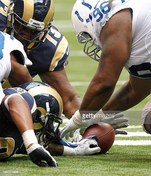 Indianapolis Colts defensive tackle Brandon McKinney grabs this loose ball from St Louis Rams running back Isaiah Pead in first half action for the...