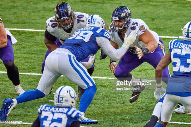 Indianapolis Colts defensive tackle DeForest Buckner battles with Baltimore Ravens offensive guard D.J. Fluker and Baltimore Ravens offensive guard...