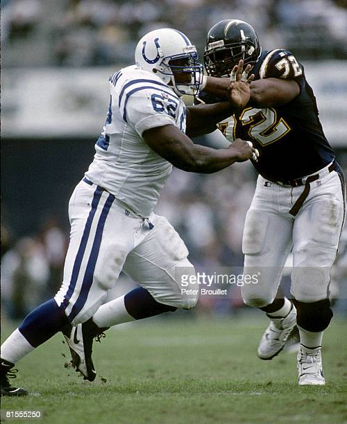 Indianapolis Colts defensive tackle Ellis Johnson tussles with San Diego Chargers offensive lineman Harry Swayne during the AFC Wildcard Playoff, a...