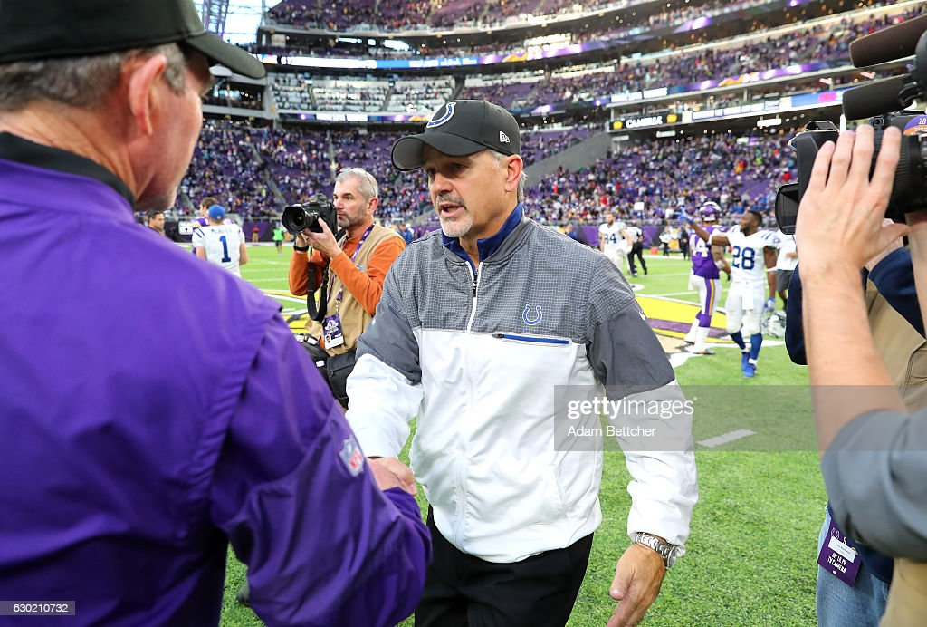 Indianapolis Colts head coach Chuck Pagano greets Minnesota Vikings head coach Mike Zimmer after the game on December 18, 2016 at US Bank Stadium in Minneapolis, Minnesota. The Colts defeated the Vikings 34-6.