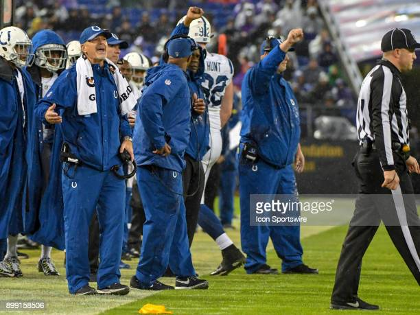 Indianapolis Colts head coach Chuck Pagano has words with line judge Bart Longson after a pass interference call against his team on December 23 at...
