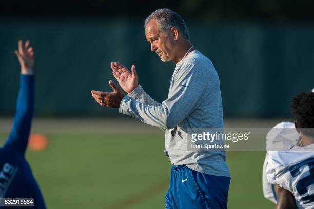 Indianapolis Colts head coach Chuck Pagano walks around talking to his players before the Indianapolis Colts training camp practice on August 16 2017...