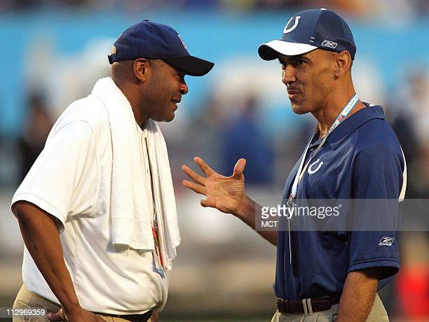 Indianapolis Colts head coach Tony Dungy, right, talks with Chris Matlock before Super Bowl XLI in Miami, Florida, on Sunday, February 4, 2007.