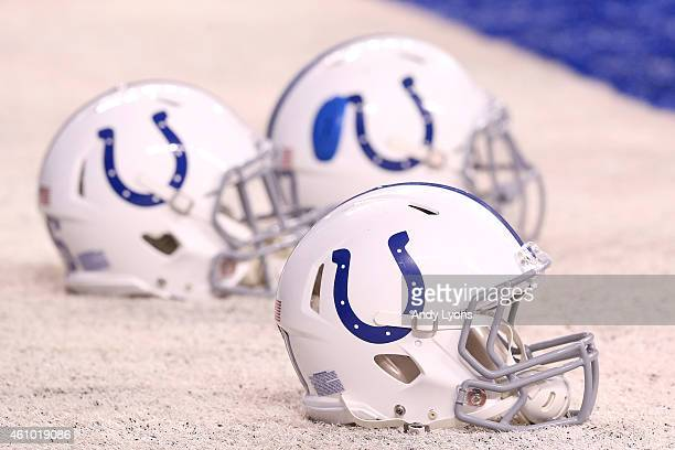 Indianapolis Colts helmets rest on the sidelines during the pregame warmup before the AFC Wild Card game against the Cincinnati Bengals at Lucas Oil...