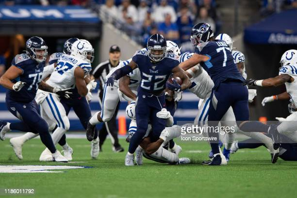 Indianapolis Colts linebacker Anthony Walker pulls down Tennessee Titans running back Derrick Henry during the NFL game between the Tennessee Titans...