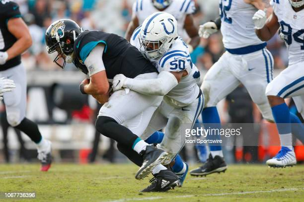 Indianapolis Colts Linebacker Anthony Walker tackles Jacksonville Jaguars Quarterback Cody Kessler during the game between the Indianapolis Colts and...