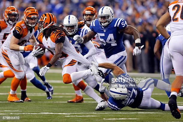 Indianapolis Colts linebacker Josh McNary tries to bring down Cincinnati Bengals corner back Adam Jones during the AFC WildCard football game between...