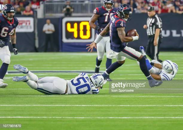 Indianapolis Colts middle linebacker Anthony Walker tries to bring down Houston Texans quarterback Deshaun Watson during the AFC Wild Card game...