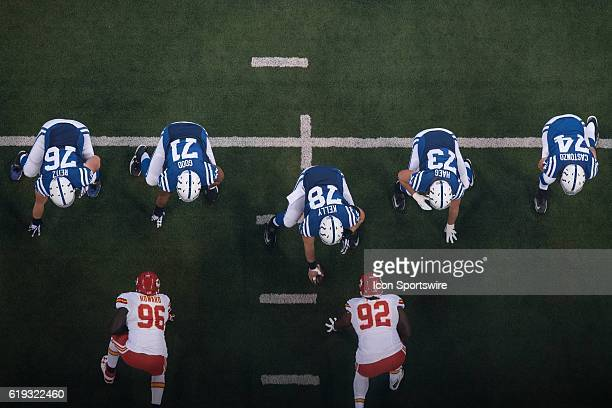 Indianapolis Colts offense line gets ready for the snap during the NFL game between the Kansas City Chiefs and Indianapolis Colts on October 30 at...