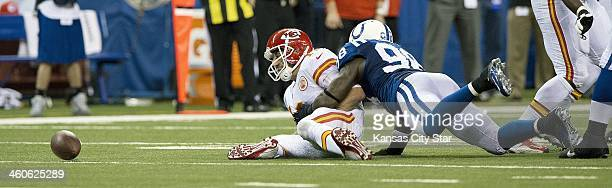 Indianapolis Colts outside linebacker Robert Mathis forces Kansas City Chiefs quarterback Alex Smith to fumble the ball in the third quarter of an...