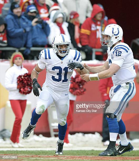Indianapolis Colts quarterback Andrew Luck celebrates with running back Donald Brown after his touchdown in the third quarter at Arrowhead Stadium in...