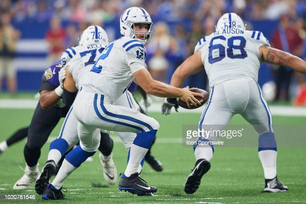 Indianapolis Colts quarterback Andrew Luck handles the football in action during the preseason NFL game between the Indianapolis Colts and the...