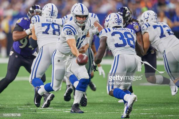 Indianapolis Colts quarterback Andrew Luck hands the football to Indianapolis Colts running back Christine Michael the football in action during the...