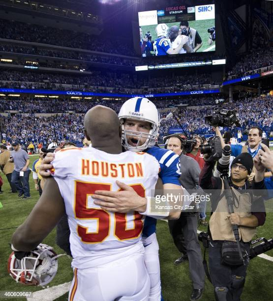 Indianapolis Colts quarterback Andrew Luck hugs Kansas City Chiefs outside linebacker Justin Houston following the Colts' 4544 win in an AFC Wild...