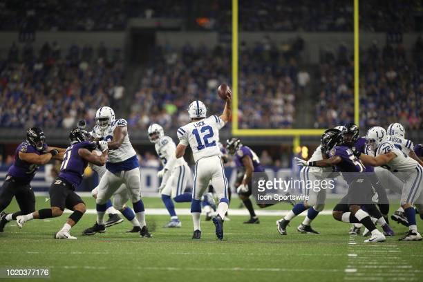 Indianapolis Colts quarterback Andrew Luck throws the football down field in action during the preseason NFL game between the Indianapolis Colts and...
