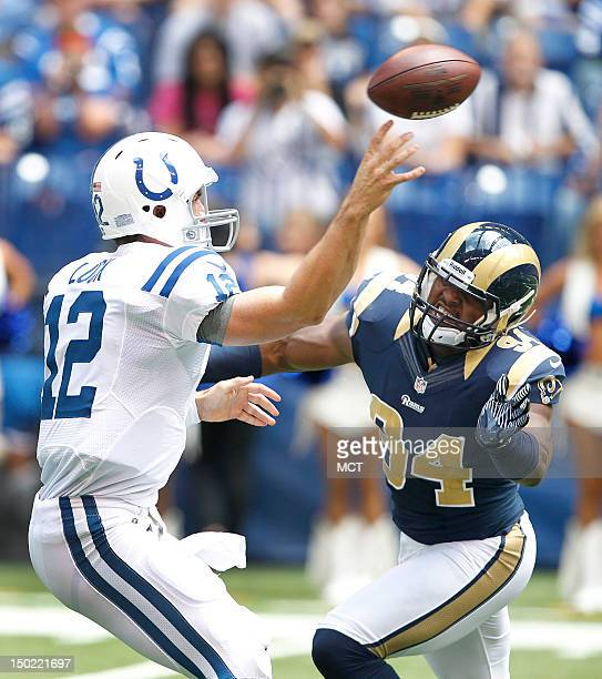 Indianapolis Colts quarterback Andrew Luck throws under pressure from St Louis Rams defensive end Robert Quinn in the first half The Indianapolis...