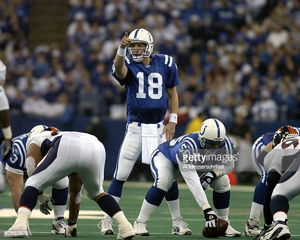 Indianapolis Colts quarterback Peyton Manning calls a play at midfield at the RCA Dome Indianapolis Indiana January 4 2004 in an AFC wildcard playoff...