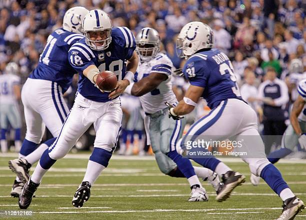 Indianapolis Colts quarterback Peyton Manning hands off to Indianapolis Colts running back Donald Brown in the 1st quarter at Lucas Oil Stadium in...