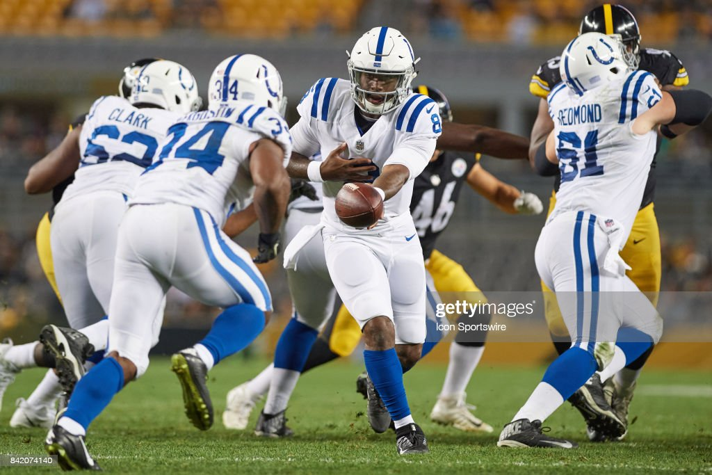 Indianapolis Colts quarterback Phillip Walker (8) hands the ball to Indianapolis Colts running back Josh Ferguson (34) during the NFL preseason football game between the Pittsburgh Steelers and the Indianapolis Colts on August 26, 2017 at Heinz Field in Pittsburgh, PA.