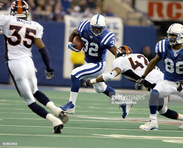 Indianapolis Colts running back Edgerrin James rushes for a gain in the first half at the RCA Dome Indianapolis Indiana January 4 2004 in an AFC...