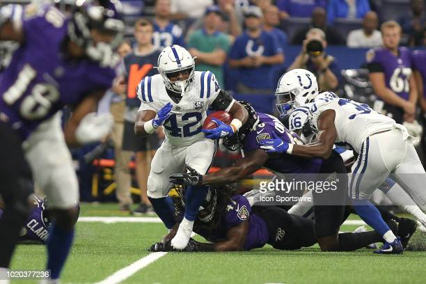 Indianapolis Colts running back Nyheim Hines runs with the football in action during the preseason NFL game between the Indianapolis Colts and the...