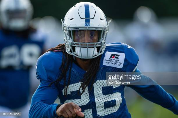 Indianapolis Colts safety Clayton Geathers warms up on the field before the Indianapolis Colts training camp practice on August 5 2018 at the Grand...