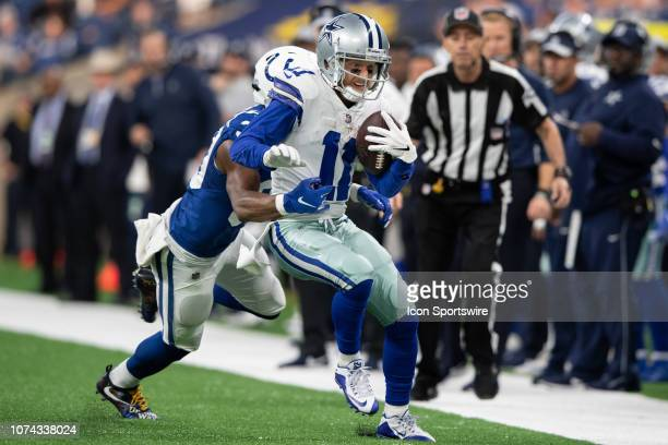 Indianapolis Colts safety George Odum tackles Dallas Cowboys wide receiver Cole Beasley on the sidelines during the NFL game between the Indianapolis...