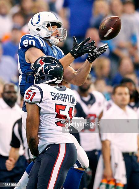 Indianapolis Colts tight end Coby Fleener just misses this pass against Houston Texans inside linebacker Darryl Sharpton in first half action The...