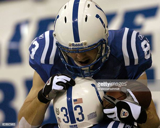 Indianapolis Colts wide receiver Brandon Stokley scores the opening touchdown at the RCA Dome Indianapolis Indiana January 4 2004 in an AFC wildcard...