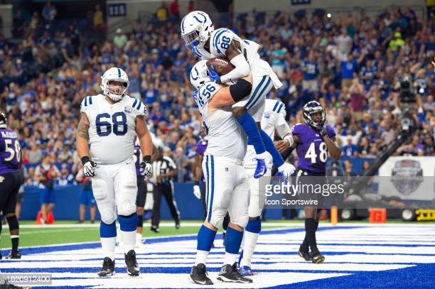 Indianapolis Colts wide receiver Chester Rogers and Indianapolis Colts guard Quenton Nelson celebrate a fumble recovery for a touchdown during the...