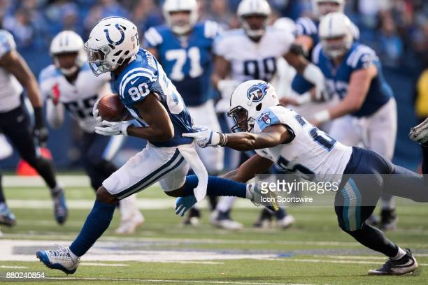 Indianapolis Colts wide receiver Chester Rogers gets away from a diving Tennessee Titans cornerback Adoree' Jackson during the NFL game between the...