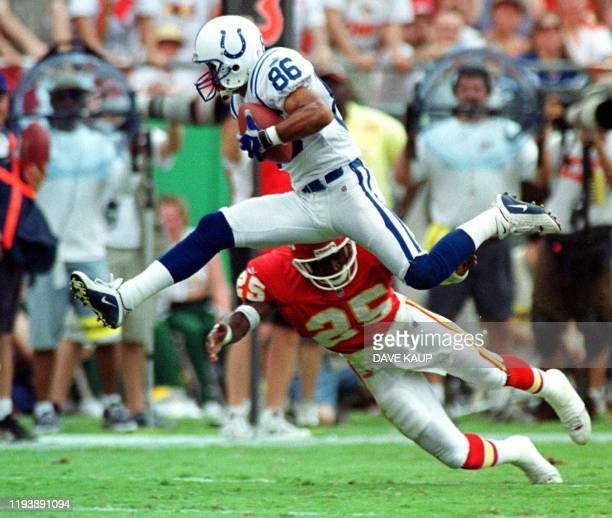 Indianapolis Colts wide receiver Jerome Pathon leaps through the air to avoid a tackle by Kansas City Chiefs Greg Wesley during a 33yard reception...