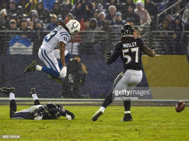 Indianapolis Colts wide receiver TY Hilton cannot catch a pass in a heavy rain against Baltimore Ravens free safety Eric Weddle and inside linebacker...