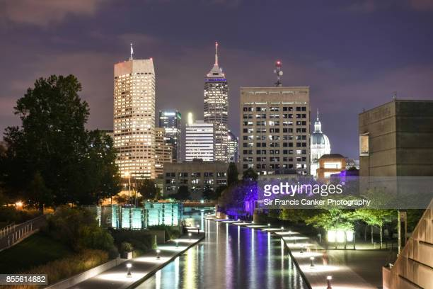 Indianapolis skyline illuminated at late dusk and reflected on White river canal in Indiana, USA